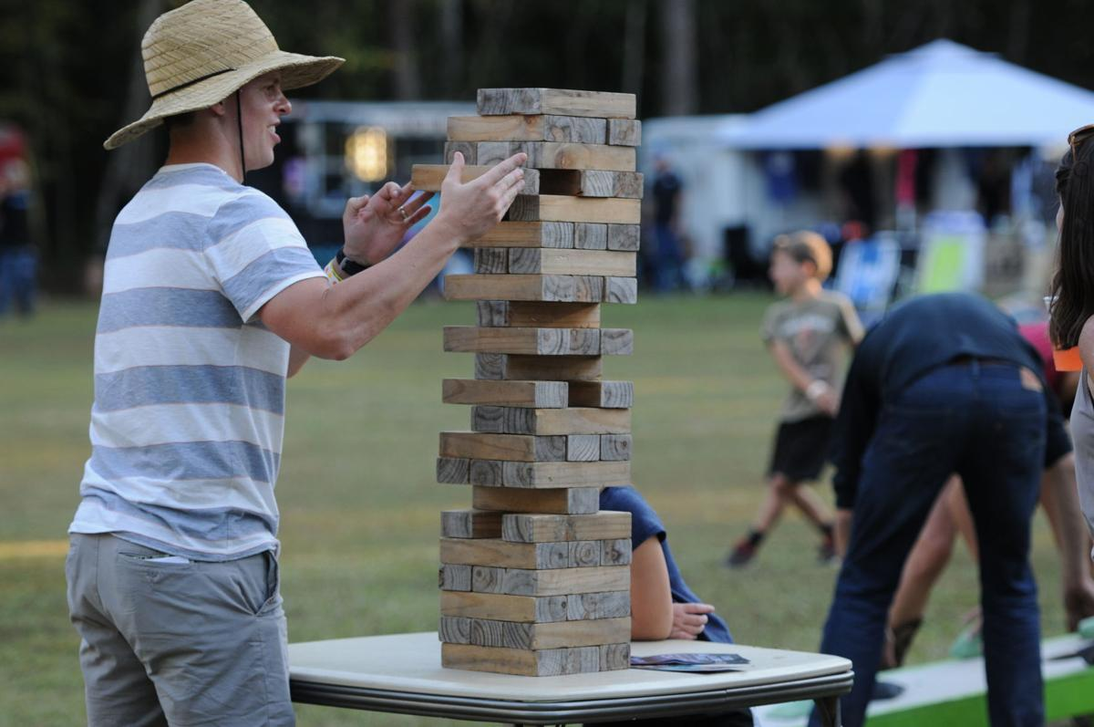 Greg Hyland takes a turn during a game of Jenga