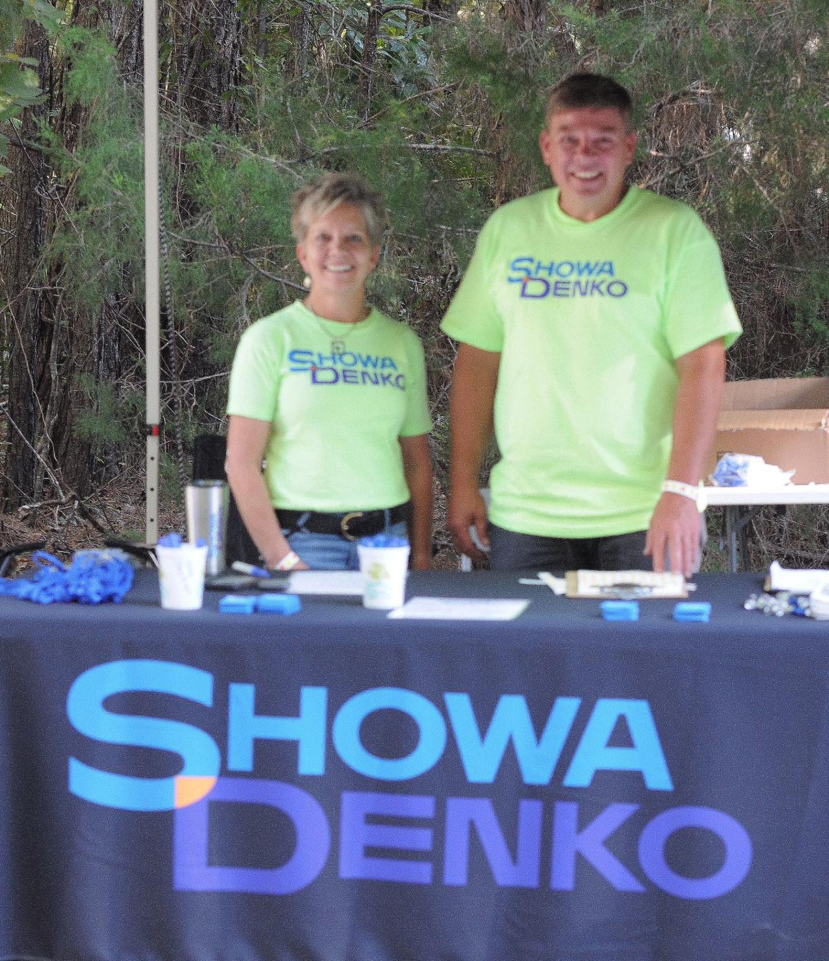 Debra and Derrill Austin of Showa Denko Carbon, Inc. welcome people to the Edisto Blackwater Boogie festival. By Roger Lee
