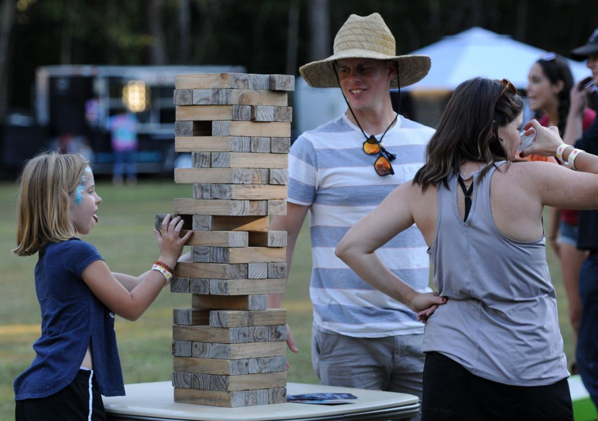 Mae Hyland takes a turn during a game of Jenga. By Roger Lee